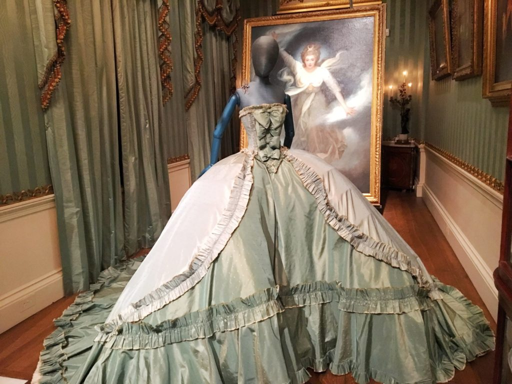John Galliano marquise marquee ball gown dress with the famous painting of Georgiana, Duchess of Devonshire as 'Cynthia', in the background