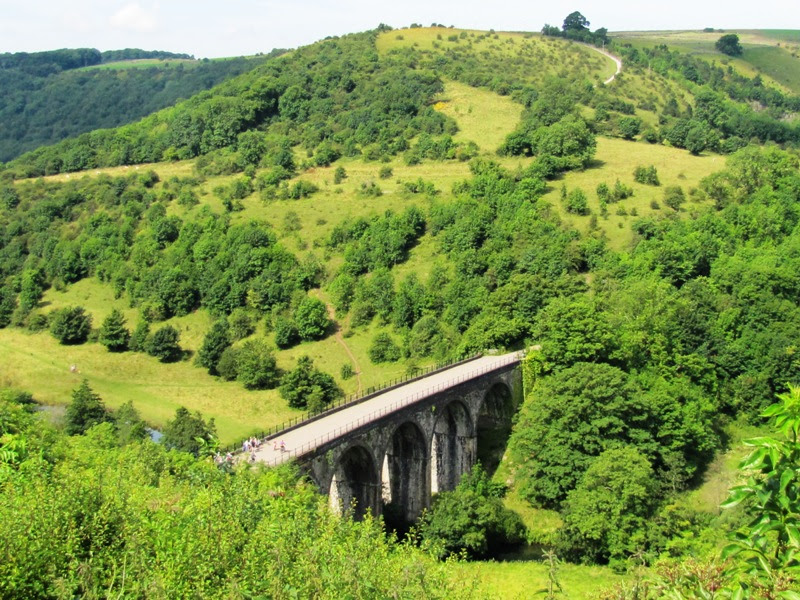 A Photo from Monsal Trail Bike Hire website of the viaduct at Monsal Head and lush green rolling hills in the background