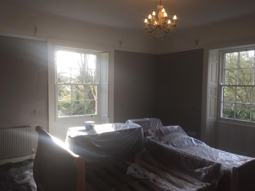 Dovedale bedroom at Darley House with furniture under dust sheets, undergoing decorating